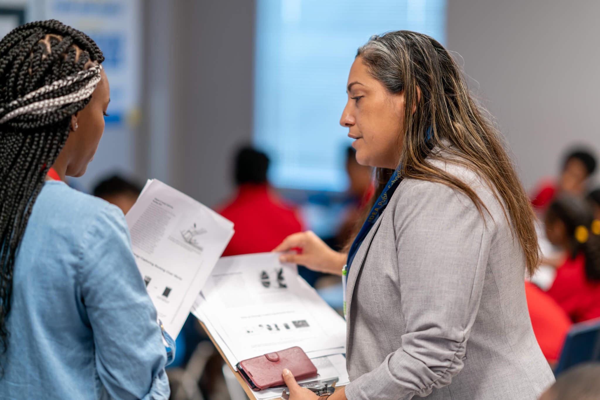 Richel Raich-Cantu works with a teacher during her classroom coaching rounds.